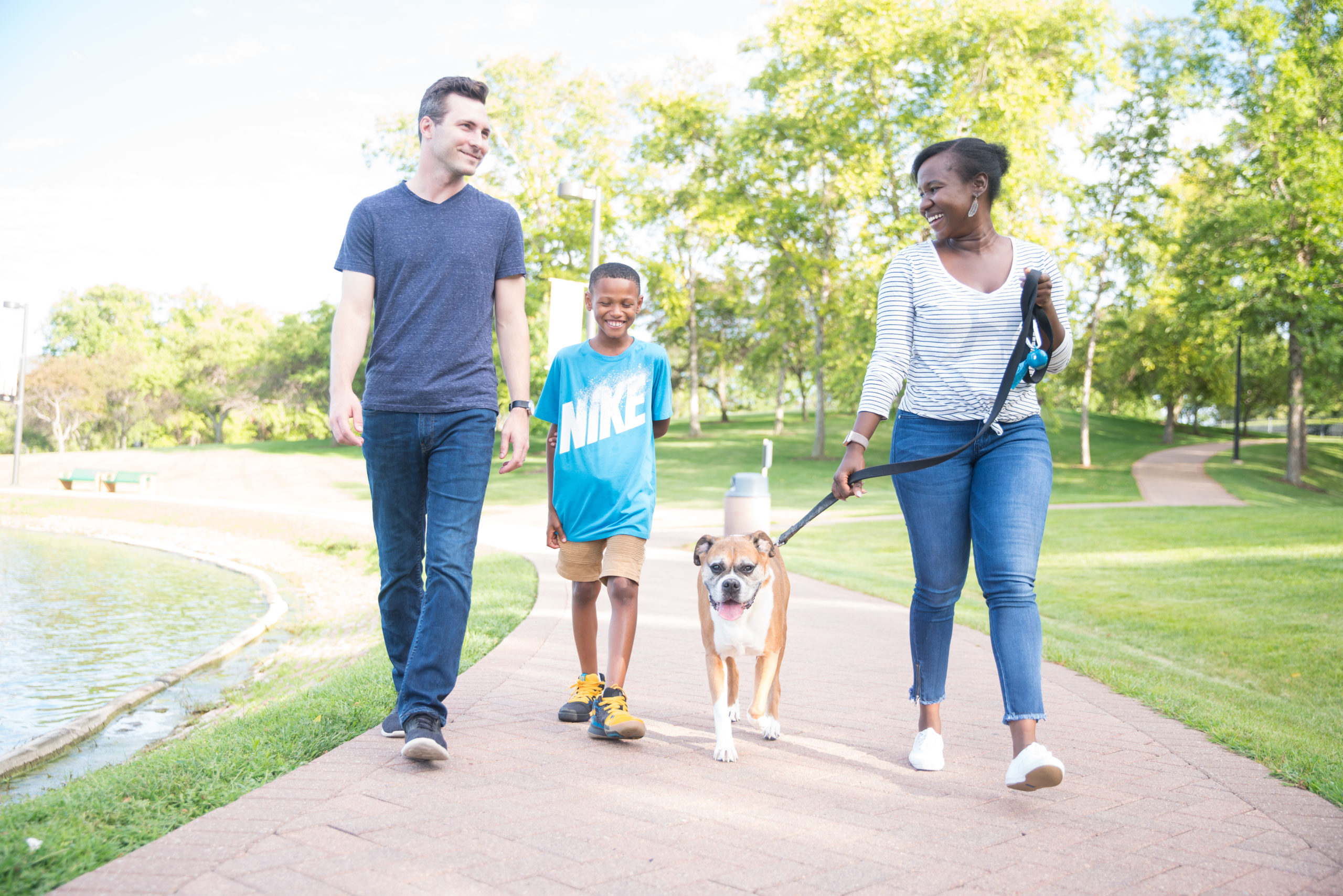 mentor, youth, parent, and their dog